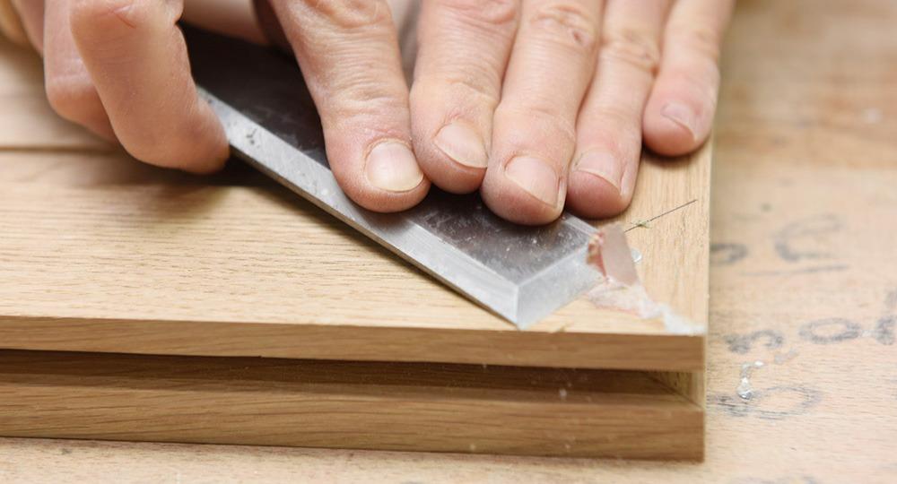 Afleurage des coupes d'onglet